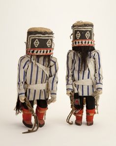 """Exhibition """"Hopi Katsina Dolls: 100 Years of Carving"""" Mots'inkatsina or Disheveled Katsina, pre-1901 The disheveled hair of these Katsinam gives them their name. Alph Secakuku said their function is to """"carry out public order, such as policing public works projects … They are mean spirits and not afraid to use the whips they carry."""" Collected by Frederick Volz for the Fred Harvey Company, 832CI"""