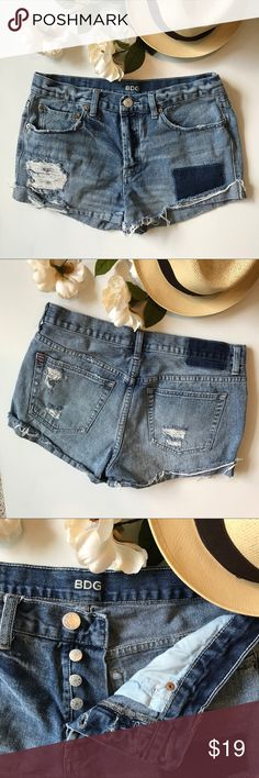 BDG Distressed Jean Shorts These BDG distressed jean shorts have a great look to them. A little worn but still a great pair of shorts for those warm summer nights! A-22 BDG Shorts Jean Shorts