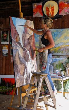 Holly Friesen painting in her Canadian art studio #workspace.
