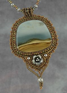 This picture jasper cab looks like a beach! Bead artwork by Sue Horine