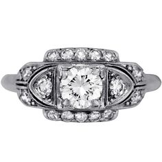I am IN LOVE with vintage/art deco engagement rings.