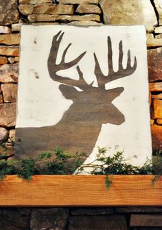 Deer Head Silhouette On Distressed Pallet Wood By