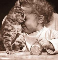 vintage photo of baby and cat