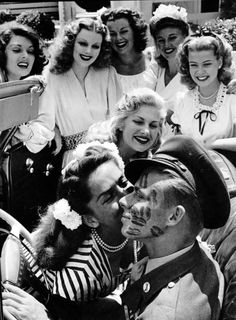 John Farnsworth covered in kisses by famous pinups and actresses (L to R: Lynne Baggett, Dolores  Moran, Barbara Hale, Ginger Rogers, Gloria DeHaven, Chilli Williams and Jinx Falkenburg.) 1944