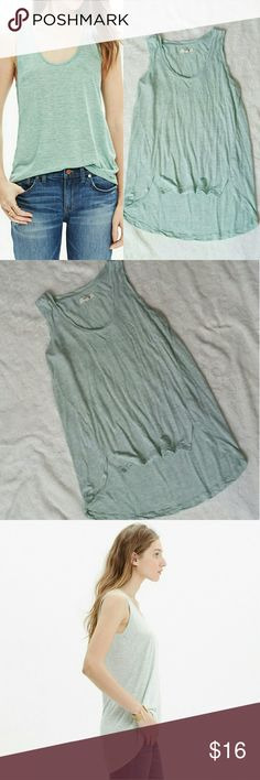 "MADEWELL Scoop Neck Anthem Tank In Mint This tank is a soft, heathered, mint color. NWOT, flawless. Uneven hem, Scoop neck, material info on photos. Neck to front hem 16"", neck to back hem 22"", underarm to underarm 17"". Madewell Tops Tank Tops"