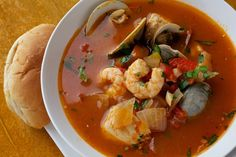Cioppino is really a humble fisherman's stew -- but it's alluring and impressive-looking, with chunks of fresh fish and shellfish piled in a fragrant tomato broth. Sub extra stock for the white wine for Phase 3.