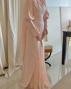"""TIARA AWATIF on Instagram: """"Pretty in peach 🍑 @tiaraawatifofficial minimal reception dress in soft peach, this floor length dress features hand pleated neckline with…"""" Hijab Dress, Floor Length Dresses, Minimalism, Reception, Peach, Neckline, Pretty, Instagram, Peaches"""
