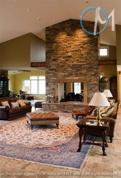 Two-Sided Fireplace Designs | The two-sided fireplace is surrounded with Madura Gold Granite, and is ...
