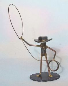 WELDED NUT and BOLT COWBOY with HIS LARIAT I have 8 of these Cowboy with their Lariats. They were made about 25 years ago by a friend and I cant get any more. These little guys, like the other little Cowboy Sculptures, make great gifts! The Cowboy stands 2 3/4 inches tall (counting