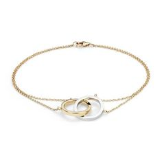 This bracelet will help you keep your look effortless, featuring yellow gold double cable chains and interlocking two tone circles.