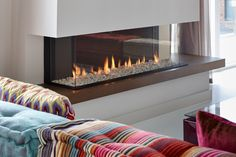 3 sided, glass fronted, gas fireplace, contemporary modern style.