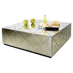 "Wood and glass coffee table with mirrored panels and a latticed design.  Product: Coffee tableConstruction Material: Wood and mirrored glassColor: SilverDimensions: 18"" H x 53"" W x 53"" D"