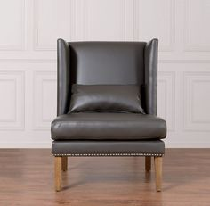 Chelsea Grey Leather Wing ChairInspired by its namesake, the posh New York neighborhood, the Chelsea chair combines the rare qualities of chic design and traditional comfort. The Chelsea Wing Chair is available in Grey or cream bonded leather.Dimensions30.5