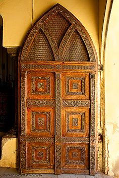 Rear door (open doorway to the right) of the Anglican Church of Tanzania in Stone Town, Zanzibar, Tanzania.