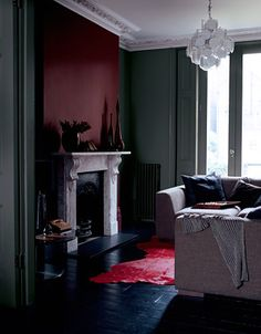 Dark, rich colors and that amazing light fixture...someday I will live here.
