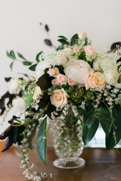 A wonderfully organic and textured bridal bouquet of peonies and roses in the softest shades of peach and rich cream, that just couldn't be any more lovely!
