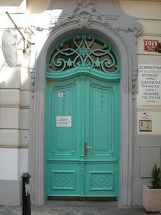 love the bright colored door against the neutral facade