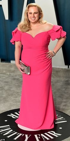 Think pink! Rebel Wilson looked stunning in an electric pink dress with puffy sleeves...