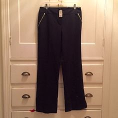 NWT Limited Dress Pants w/ Zipper Detailing, Black Dress pants with stretch to them. Silver zippers accent both the pockets and ankles for a great modern look. Size 6. Originally $60, I got them on sale for $50 as a gift for my sister but they didn't fit her so they are NWT, never worn, tried in only once. The Limited Pants
