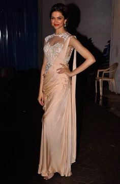 "Deepika Padukone in an elegant ""sari gown"".  Modern (and easy to manage!) take on a traditional garment <3"