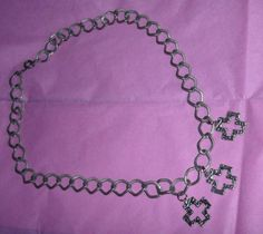 Iron Cross Necklace showcases three iron crosses made of pewter, falling from an antiqued-silverplate, large-linked chain. Crosses are covered
