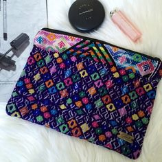 "Ketzali Textile Makeup Bag. Price firm. Ketzali ""Utiw Recycled Textile Make-up Bag. Each Ketzali bag is handmade in Guatemala with care and dedicated skill and is one of a kind! Size is 10"" L x 7"" H. Ketzali Bags Cosmetic Bags & Cases"