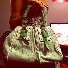 Nwot large green purse from Macy's I'm not sure of the brand but I got it in Macy's a while back. It's a pale green with 2 compartments of equal size, it's a very spacious roomy purse. Really cute I've just never worn it. Macy's Bags