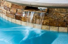 Stacked #stone spillway #pool #spa http://calpool.com