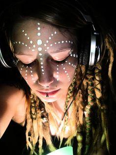 DJane | Love the tribal face paint #dreadlocks