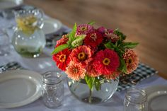 Coral zinnia and basil centerpiece by Field Sustainable Floristry.