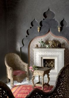 great chairs and a feature wall above the fireplace. a true boho inspired space
