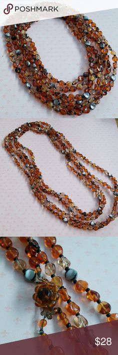 Vintage West Germany Multi Strand Necklace Vintage  Excellent vintage condition  2 strand long bead necklace with vintage clasp Varying shades of Amber and gold Wrap or wear long. Layer with other pieces for a modern look💕 Glass beads Vintage Jewelry Necklaces