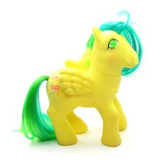 This vintage G1 My Little Pony is Masquerade, she's one of the Twinkle Eyed Ponies from Year 4. She's a yellow pegasus and has a colorful mane and tail with stripes of blue-green, blue, green, and yel