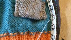 Montering av glidelås og pyntebånd.