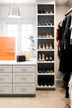 Walk-in closet features a tall show rack beside a custom island topped with marble counters and gray shaker cabinets. Mirrored Wardrobe Doors, Mirror Closet Doors, Custom Walk In Closets, Walk In Closet Design, Modular Closets, Closet Island, Built In Dresser, White Closet, Master Closet