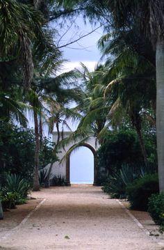 Florida Memory - View looking down a path toward a gateway to the beach in Boca Grande, Florida.