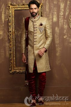 Golden Jacquard Silk Wedding Wear Heavy Embroidery Work Sherwani. For more information :- Call us @+919377222211 (Whatsapp Available)