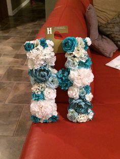 Diy flower letter. Floral stems, wooden letter, hot glue, paint. Perfect for front door or baby nursery!