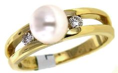 Diamond and pearl ring. Check out Eddie Lane's Engagement Ring Style Quiz: http://on.fb.me/1rYtXMT