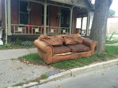 Brown Leather sofa.  Betting this was a gem when it was new.  Green Street, Ithaca NY.