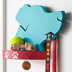 Collar those canine accessories with style. Create a dog-theme shelf and leash holder plus a paw-print wall hook. Skill level: Beginner