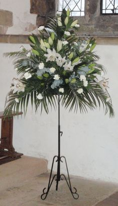All white Church Pedestal Arrangement, with white lilies, carnations and lots of lovely foliage