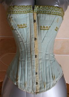 Corset in blue cotton top with trimmings in green - 1900