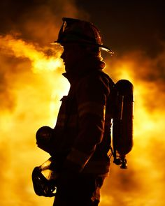 Firefighter at a blazing fire on a freezing night. (© Jon C. Hodgson)   Shared by LION