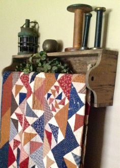 The tool box belonged to my DH's grandfather.  Perfect quilt rack.