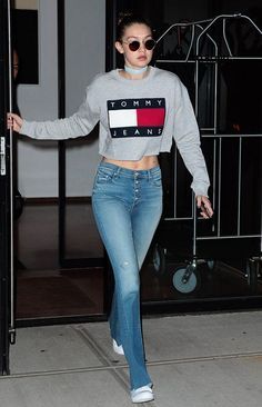 Gigi wearing the perfect crop top sweatshirt + jeans situation.