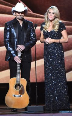 All Noir from Carrie Underwood's Pregnancy Style  Both Carrie and Brad Paisley work all-black ensembles.