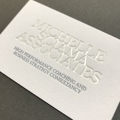 White foil and grey letterpress business cards printed onto Colorplan papers