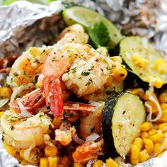 Corn, zucchini, and coconut-lime marinated shrimp grilled in foil-packets makes for one easy, delicious, 30-minute summer dinner!
