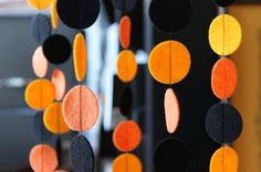 Halloween Garland/Hanging Curtain - felt dots on string. Could do it better with wooden circles or polymer clay cutouts with holes punched thru...